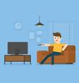 young man watching television at home vector image
