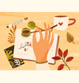 cozy autumn composition with hand holding branch vector image