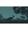 Silhouette of parasaurolophus walking in fields vector image vector image