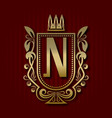 golden royal coat of arms with n monogram vector image vector image