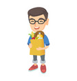 boy holding paper shopping bag full of groceries vector image vector image