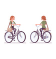 young red-haired woman riding a bicycle vector image