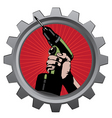 hand with drill in metal badge