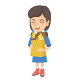 girl holding paper shopping bag full of groceries vector image