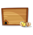 A hatched egg near an empty board vector image vector image