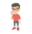little caucasian boy holding a lollipop candy vector image vector image