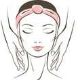 face massage in spa salon vector image