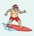 tattooed santa claus in sunglasses surfing wave vector image vector image