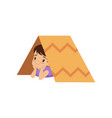 cute boy playing with tent made of cardboard box vector image vector image