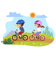 happy kids riding bicycles in the vector image vector image