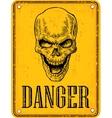 Skull on sign danger Black vintage vector image