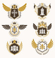 Heraldic emblems with wings isolated on white
