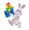 christmas rabbit with gifts vector image