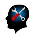 Human head with a screwdriver and wrench on