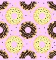white and dark chocolate donuts with pink backdrop vector image vector image