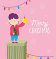merry christmas boy in gift with ball and lights vector image