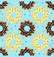 white and dark chocolate donuts with blue backdrop vector image vector image