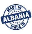 made in albania blue grunge round stamp vector image vector image
