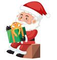 santa holding a present vector image vector image