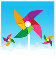 Colorful paper wind turbine on blue sky background vector image