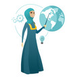 muslim business woman pointing at a globe vector image