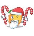 santa with candy apricot mascot cartoon style vector image vector image