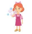 little caucasian girl blowing soap bubbles vector image