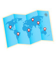fold world map with red gps icon vector image