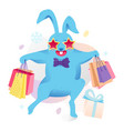 blue bunny with shopping bags vector image
