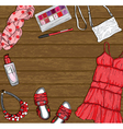 wooden background with red female fashion clothes vector image