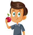 cute boy eating an apple cartoon vector image vector image