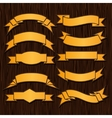 Gold retro ribbons and labels on wooden background vector image vector image