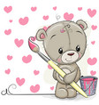 teddy bear with brush is drawing a hearts vector image