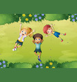 three happy kids on green grass vector image vector image