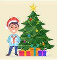 boy in santa claus hat standing near decorated vector image