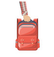 colorful school backpack in hand vector image vector image