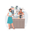 woman paying for beverage in coffee shop vector image