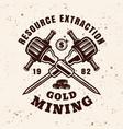 gold mining vintage emblem with jackhammers vector image
