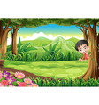 a smiling boy playing hide and seek at forest vector image vector image