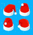 set of santa s red christmas hats isolated on blue vector image