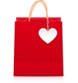 Red paper shopping bag with white heart label vector image vector image