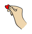 hand holding small red heart shape vector image vector image