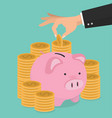 hand putting coin a piggy bank money savings vector image vector image