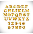 english alphabet and numerals from yellow golden vector image vector image