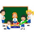 cartoon school kids studying in the classroom vector image