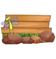 A dragonfly above the rock with an empty wooden vector image vector image