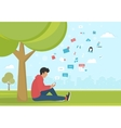 Young man sitting in the park and texting messages vector image vector image