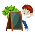 Little boy behind the chalkboard vector image vector image
