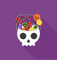 skull bucket filled with sweets and candy vector image