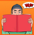 pop art amazed man holding book vector image vector image
